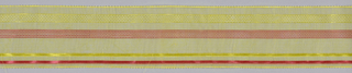 Yellow gauze ribbon with ornamental stripes in red and yellow with picot selvage. Two pieces sewn together.