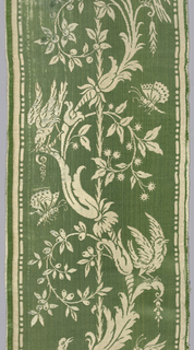 Two fragments of border pattern of baroque foliage forms with birds and insects perched on the branches or hovering about them. Pattern in extra wefts of white on green satin ground.