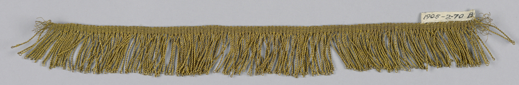 Gold fringe with a plain-woven heading and a skirt of looped and twisted threads.