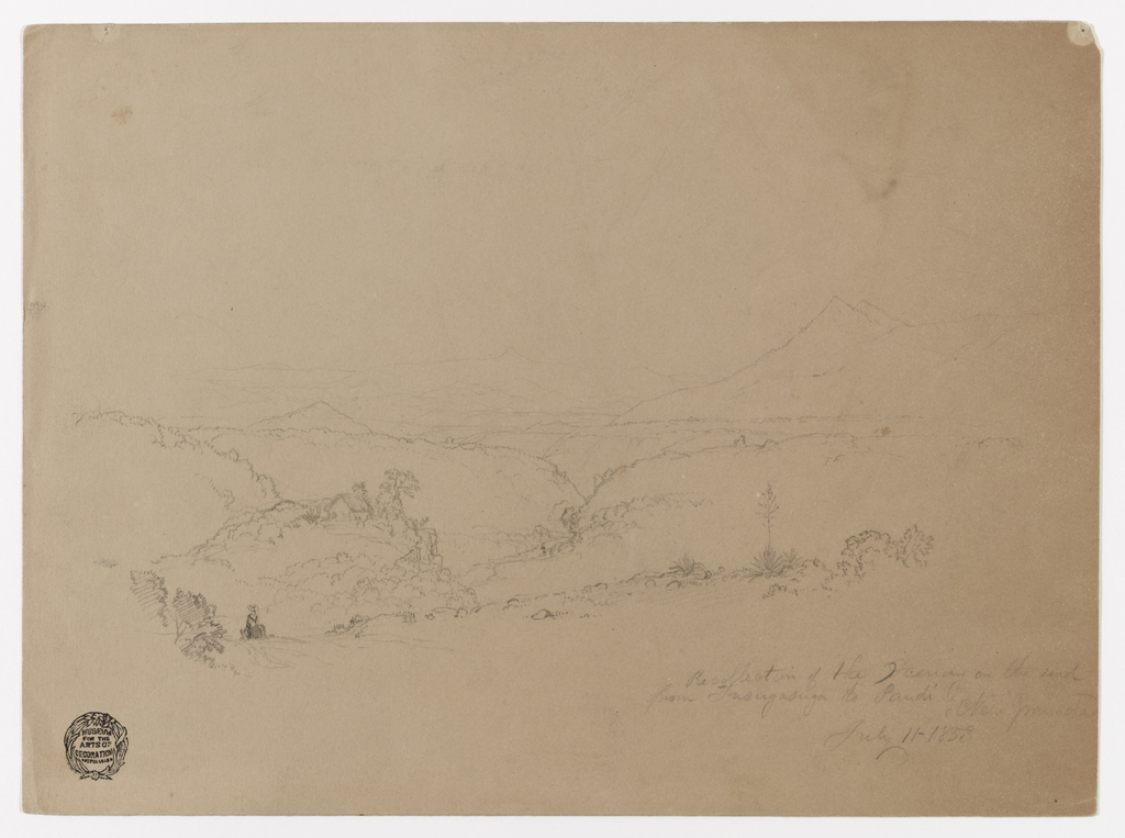Horizontal view of hills and mountains across a plateau with a steep stream bed, and of woman seen from the back riding a donkey on a sloping road in the left foreground.