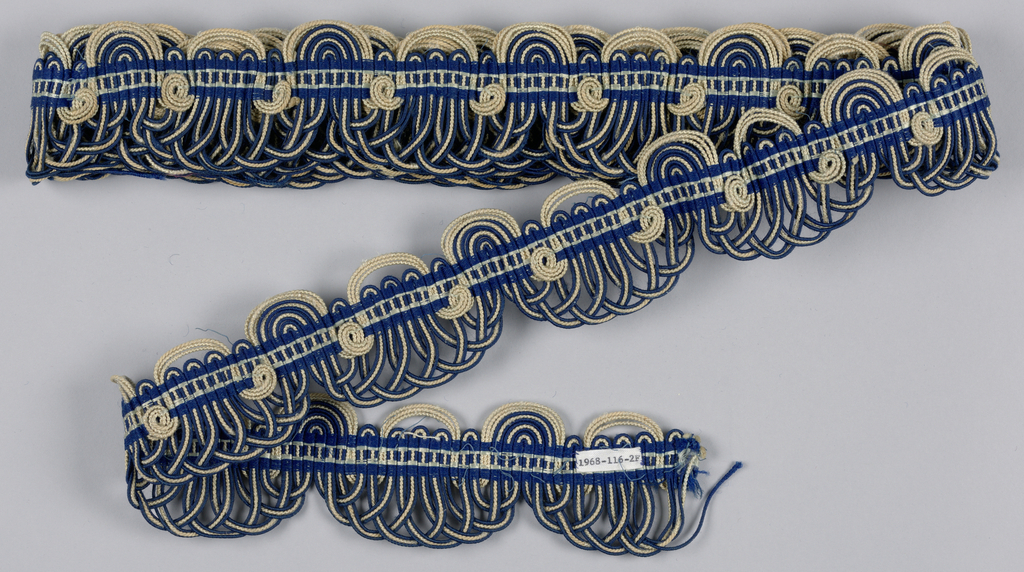 Woven looped trim in blue and white cord.