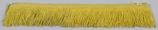 Yellow fringe with a plain-woven heading and a skirt of course yellow threads.