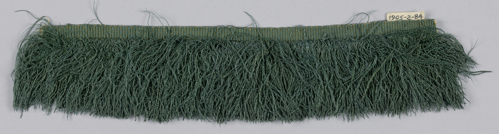 Blue-green fringe with a plain-woven heading and a skirt of green silk thread.