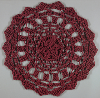 Red interlaced circular ornament.