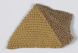 Knitted triangular object in beige and brown.