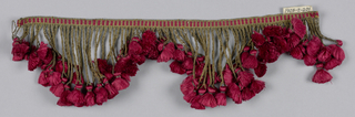 Fringe of red and gold threads with a heading and gold skirt threads of varying lengths arranged to form points; each thread supporting a small red tuft.