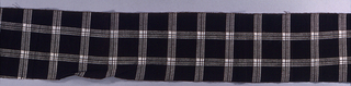 Narrow fragment of black and white plaid.