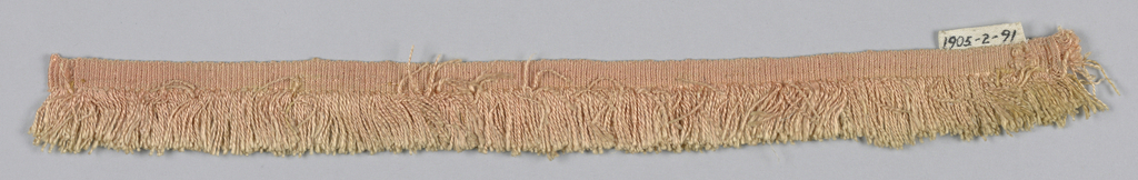 Pink fringe with a plain-woven heading and thread skirt.