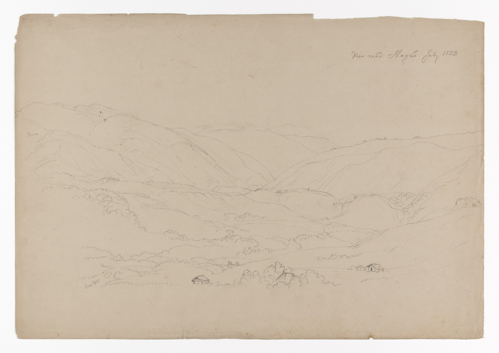 Horizontal view with the mountains filling in the background with three houses and a bridge visible in the center foreground of the valley.
