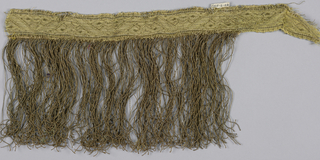 Trimming in a pattern of ornamented triangles. Attached is a fringe skirt of twisted loops with a plain-woven linen heading.