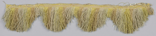 Fringe in yellow, pink and white with a plain-woven heading. Skirt threads are striped and cut into scallops.