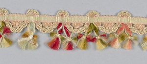 Woven heading with a cord carried through to form scallops with ornaments of silk floss knotted and fringed in multicolored silks.