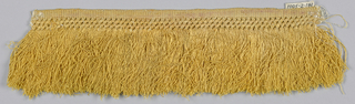 Yellow fringe with a plain weave heading, band in a trellis pattern above yellow skirt threads.