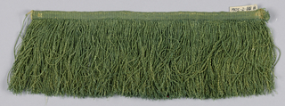 Green fringe with a plain-woven heading and a skirt of green threads.