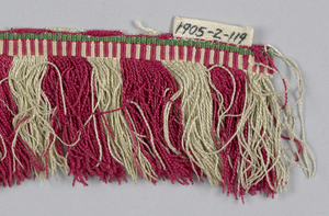 Fringe in green, red and white with a patterned heading and skirt threads arranged to form colored stripes.