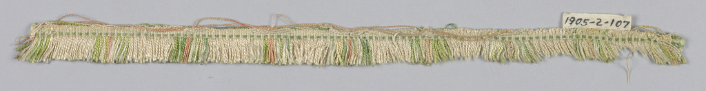 Green, pink and white fringe with a plain-woven heading and skirt threads arranged to form colored stripes.