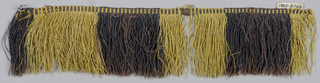 Fringe with a purple and yellow plain-woven heading. Skirts threads are arranged in stripes.