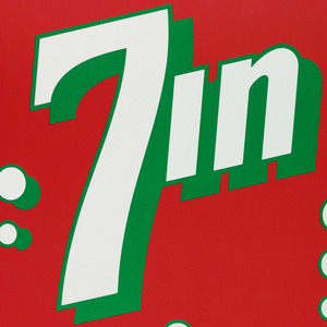 """Poster depicts a play on the 7Up soda brand. 7 in white with green outline, some """"bubbles"""" and """"in"""" is in white with green instead of """"up"""", on a red background. Below, in red ink: It was un-expected. / And clearly refreshing. / When seven of our entries / were published in CA79. / The Twentieth / Communication Arts Annual. / We're especially proud / because it happened only eighteen / months after we opened. And / we're certainly inspired to keep / pouring it on. / Because in the years ahead, we plan to move right from our / first seven on up. / [in green ink] Woody Pirtle, Inc."""