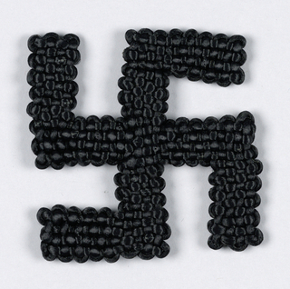 Knitted black swastika.