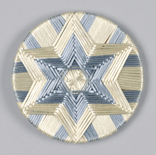 Circular panel in metallic blue and white with six-pointed star at center.