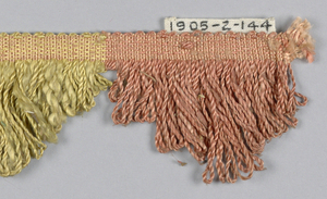 Fringe in pink, yellow and tan with a plain-woven heading. Skirt threads, looped in pink, yellow and tan stripes, are scalloped