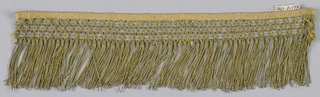 Fringe with a plain weave heading, band in a trellis pattern with horizontal threads, and a skirt of twisted loops.
