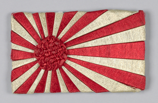 Old Japanese flag. Panel with central knotted circle in red with red and white stripes that radiate from center.