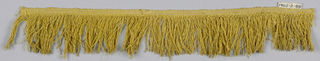 Yellow fringe with a plain-woven heading and a skirt of very fine yellow threads.