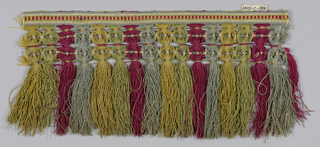 Red, blue, yellow and green fringe with heading, trellis and skirt threads arranged in stripes.