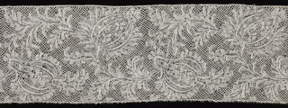 Binche-style border with swirling floral and foliated forms.
