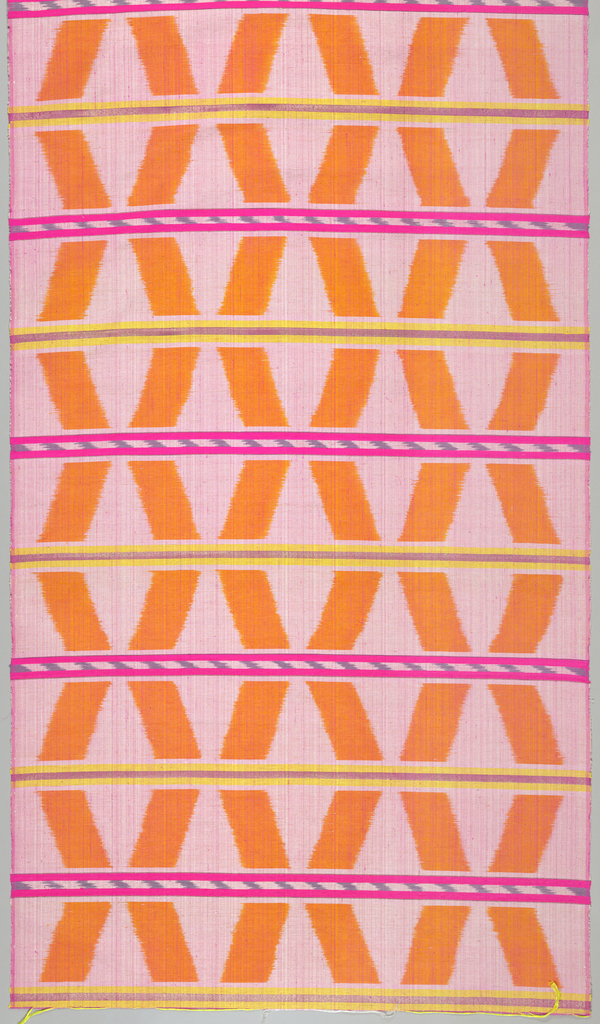 Bands of alternately s and z diagonals in orange-yellow and pink, separated by narrow gray and ivory ikat bands in solid hot pink, yellow, and metallic pink. Fine magenta warps create a changing color and surface effect.