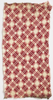 Diagonal plaid in red on white.