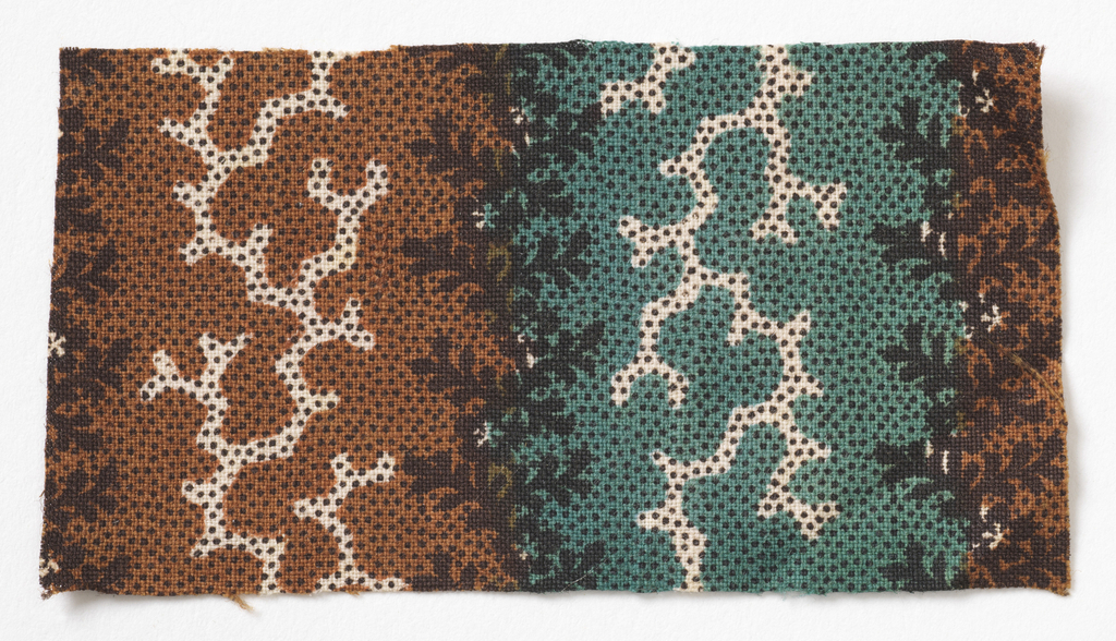 Dots and seaweed-like shapes in black, green and brown on white.