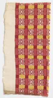Squares of two shades of red, red and white, and yellow. Large area of white unprinted cloth.