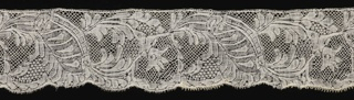 Border of Binche-style lace with an asymmetric, running floral pattern.