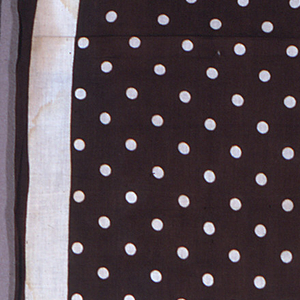 Uncut handkerchief fabric in brown on a white ground in a design of a wide white border and white dots.
