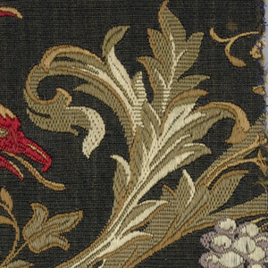 Border with a griffin on a curving vine. Colors are cream, olive green, and orange on a black ground.