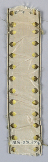 Piece of light tan ribbon with a border design of birds in brown and yellow.