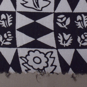 Even checkerboard of black and white squares with three patterns: black diamonds on white, an outlined flower in black on white and silhouetted floral forms in white on black.