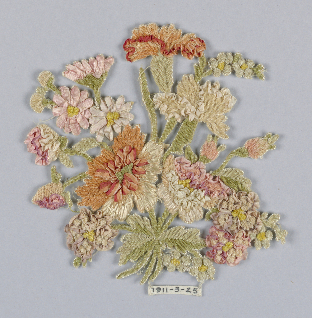Flat ornament representing a bouquet of flowers made of multicolored ribbons and chenille thread.