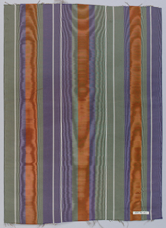 Vertically-striped wide moiré ribbon in dark orange, violet, grey-green, and white.