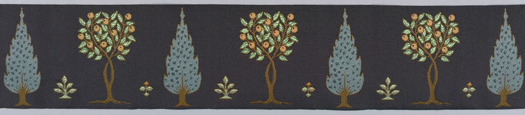 An evergreen type tree alternating with a fruit bearing tree.  Woven in greens, orange, brown with black ground.