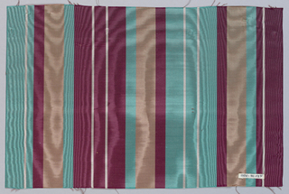 Vertically-striped wide moiré ribbon in dark red, light green, tan, and white.