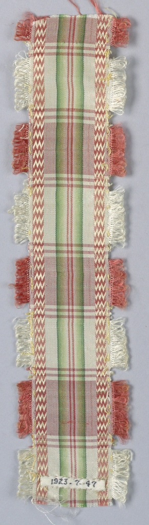 Rose, white, green and ivory plaid taffeta ribbon with rose and white loops along edges.