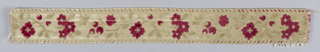 Design of a curving stem with flowers and leaves between straight borders. In red and white velvet on a white ground.
