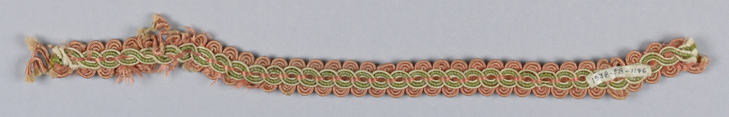 Woven upholstery trimming in design of interlacing circles bordered with semi-circles in pink, green and ivory silk.