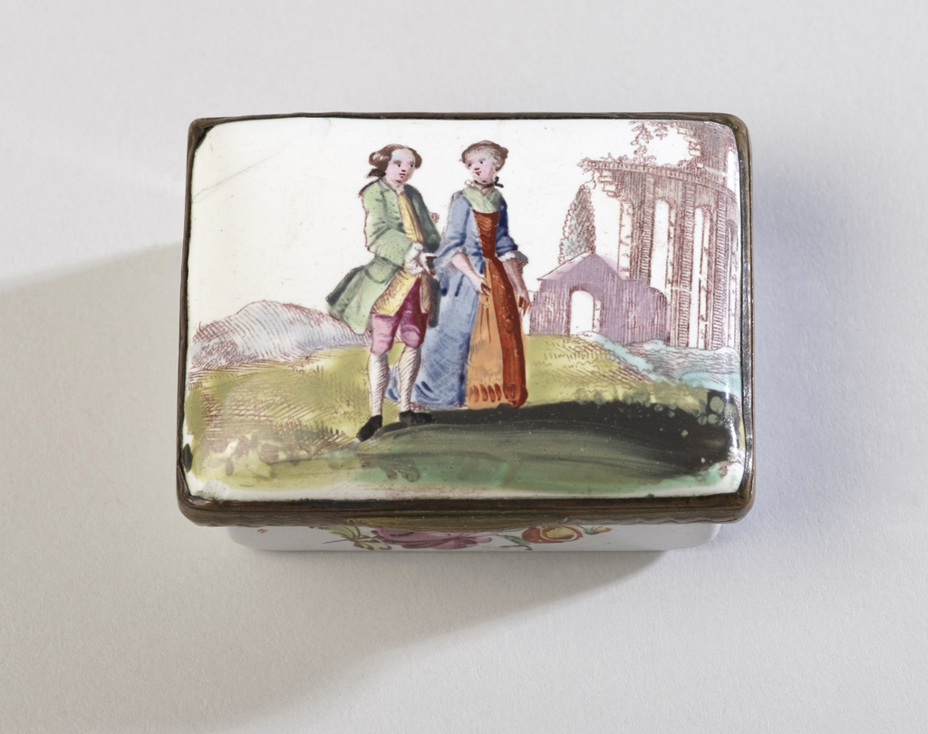 Rectangular box, white enamel field; hinged lid showing polychrome scene (painted over sepia transfer) of a couple dressed in 18th-century garb in a garden with a ruin in the background; flowers painted on four sides and bottom; white interior.