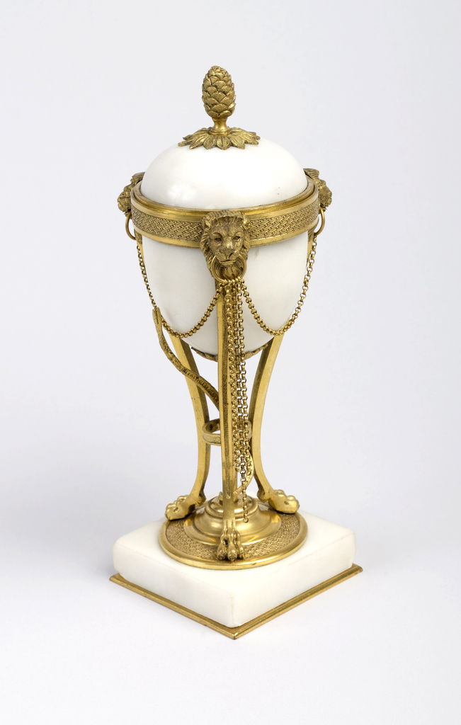 Part a, square marble plinth supporting gilt bronze tripod with lions feet and heads; snake twisted around center stem; marble bowl mounted in wide band; double chains hanging from ring held by lions' heads. Part b, dome-shaped marble lid with gilt bronze pine cone finial; interior fitted with gilt bronze nozzle for candle (can be inverted to act as candle holder).