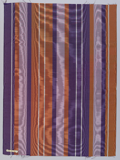 Vertically-striped wide moiré ribbon in dark and light purple, dark orange, and white.