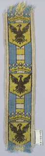 Crowned shield showing spread eagle (black on yellow); ground of light blue with central stripe with horizontal bands of yellow and white.